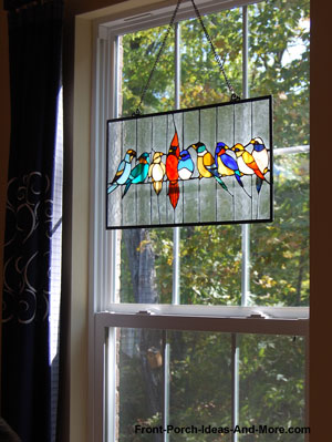 stained glass panel with a variety of birds in window