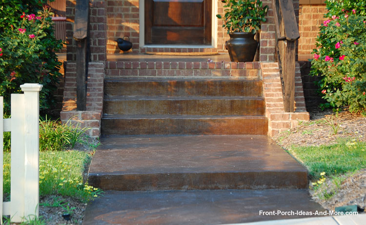Superb bronze colored concrete stained porch and sidewalk