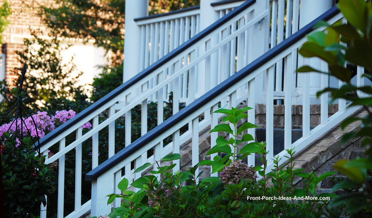 White stair hand rails with black trim
