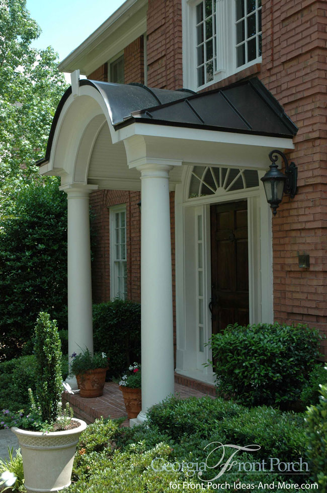 portico with barreled roof covered by standing seam metal roofing