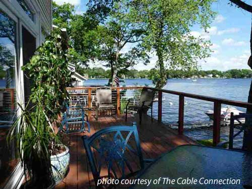 Steel Cable Railings On Porch Overlooking The Water