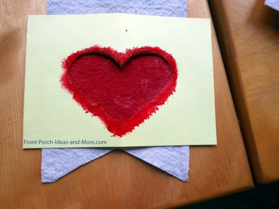 stenciled heart on drop cloth for porch garland