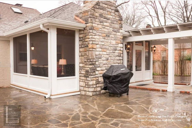 beautiful stone patio with screened porch