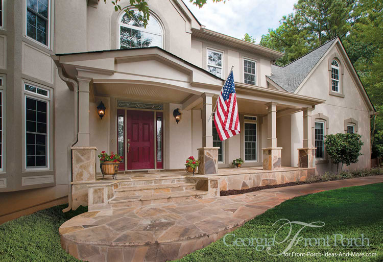 breathtaking front porch with stone pedastal columns