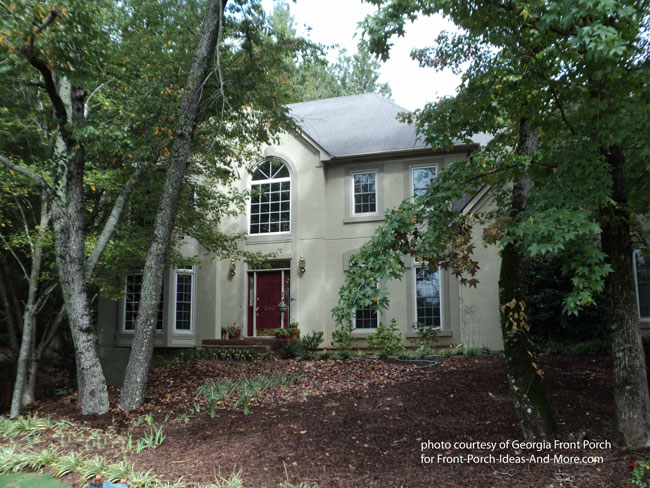 nice two story stucco home without a front porch