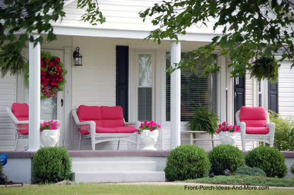 summer porch with wicker furniture and pink cusions
