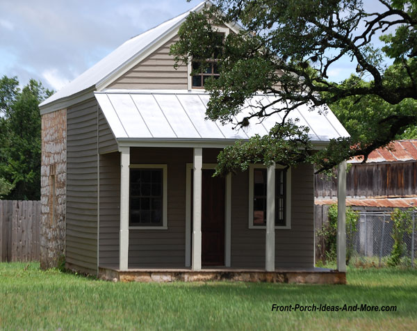 partial stone sunday house with front porch in fredericksburg texas