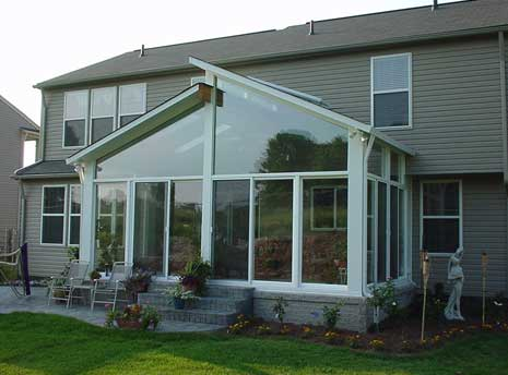 split sunroom roof design on back of home - Sunroom Design Ideas