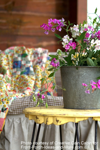 A bucket of sweet peas infuses charm for summer porch decor