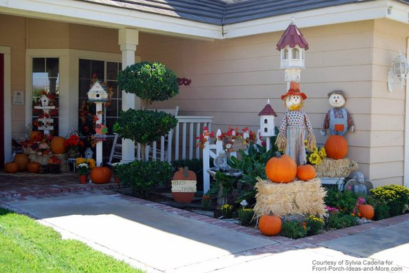 fun autumn display with scarecrows and birdhouses