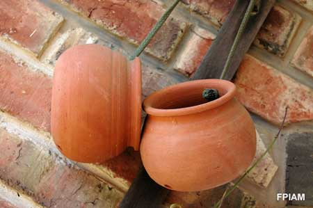 Tuscan decorating with terra cotta pots
