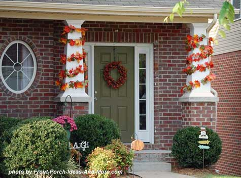 Autumn leaf garlands wrapped around front porch columns