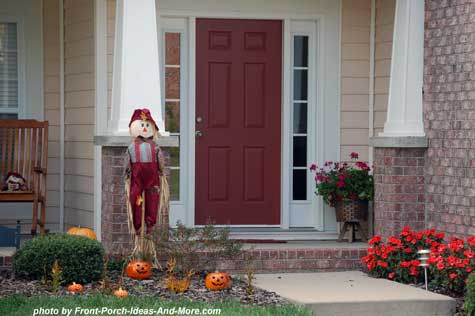 Scarecrow and pumpkins on front porch