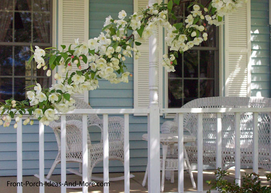 front porch in spring time with flowering tree