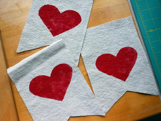 three stenciled hearts ready for the porch garland