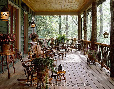 amazing view on this log porch  - photo courtesy of Roger Wade Studios