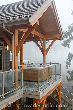 elevated log porch with hot tub - photo courtesy of Roger Wade Studios