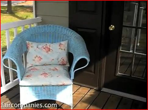 Small porch on a very small tan house