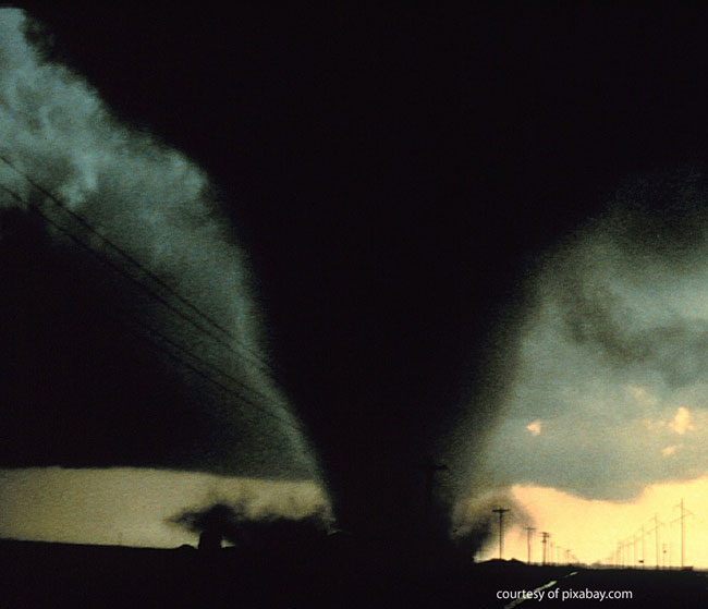 tornado touching down with car in front