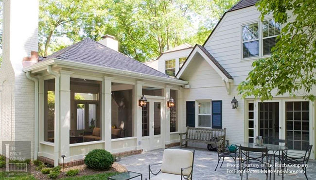 traditional patio design adjacent to screened porch