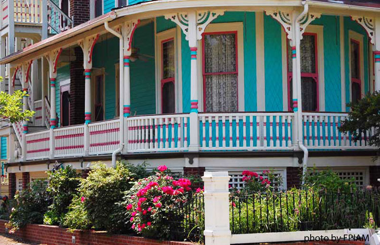 Turned porch balusters on colorful Victorian front porch