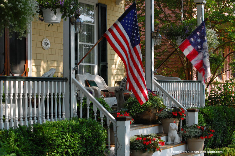 Turned porch balusters on front porch with American flag