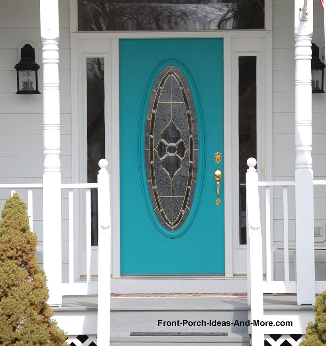 turquoise front door on front porch