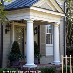 round tuscan front porch columns on small porch