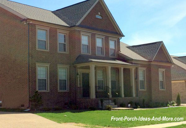 hip roof style on two story brick home