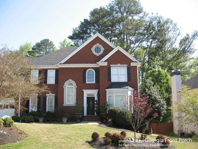 Beautiful two story brick home with portico