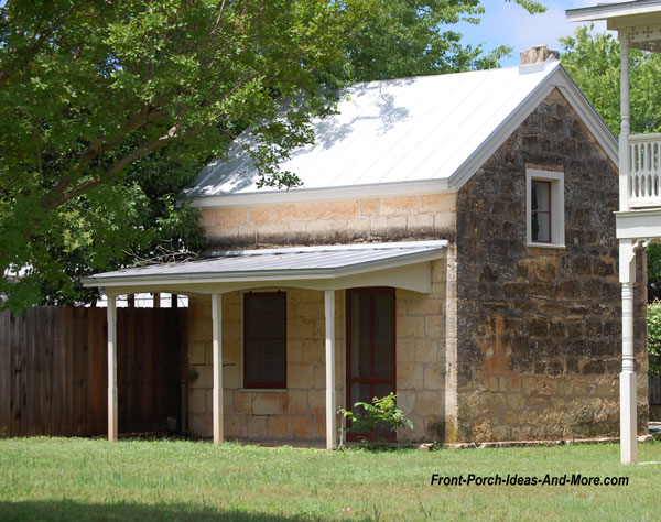 traditional stone sunday house with front porch in fredericksburg texas