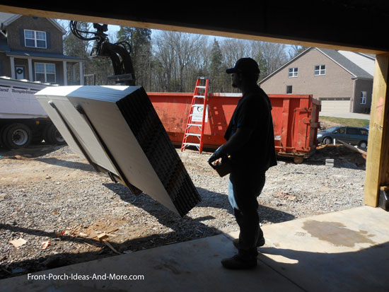 unloading drywall from truck