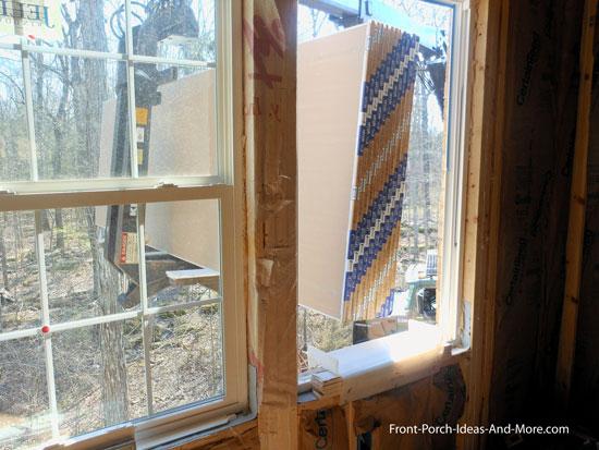 unloading drywall into second floor window