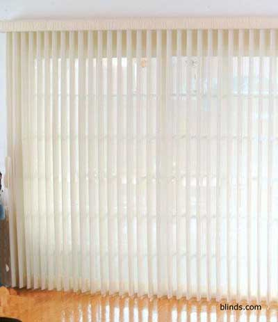 vertical blinds in sunroom as window treatment