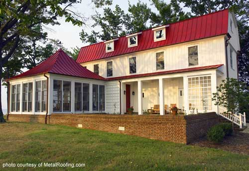 Metal Porch Roof - vertical panels on a gambrel style home with screened porch in front