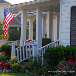 house with American Flag flying from front porch