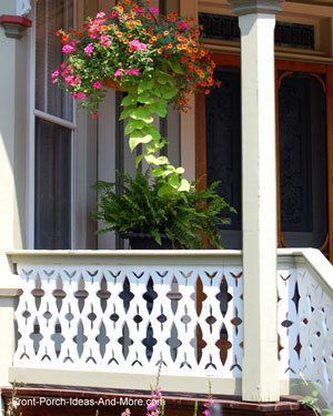 sawn balusters with colorful hanging basket on front porch