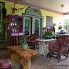 coloful victorian furniture on porch