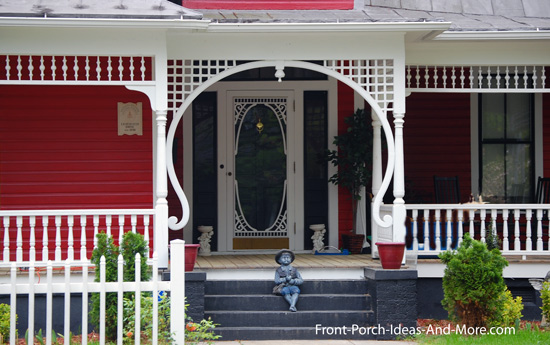 turned porch columns with amazing lattice trim