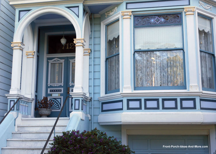 blue front porch with gold trim