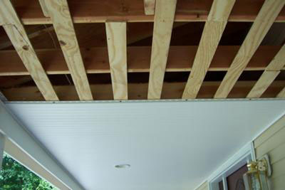 vinyl beadboard being installed on porch ceiling