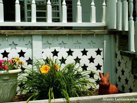 Custom vinyl lattice panels with star design on porch skirting