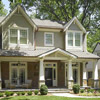 home with craftsman-style wrap around porch columns