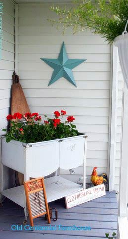 Joni's antique wash tubs filled with geraniums and two wash boards