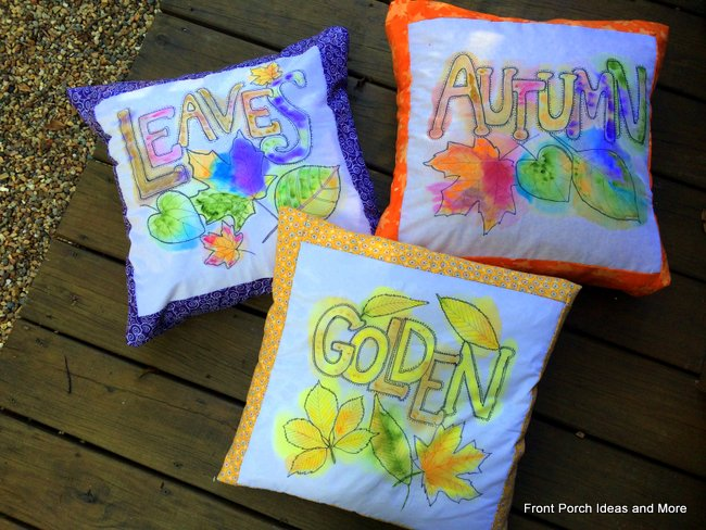 3 autumn pillows painted in watercolor