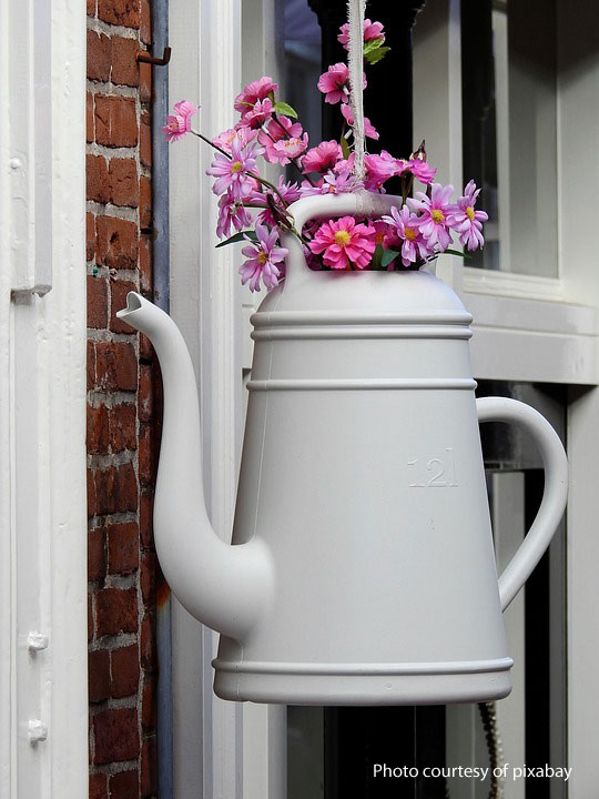 watering can planter on front porch