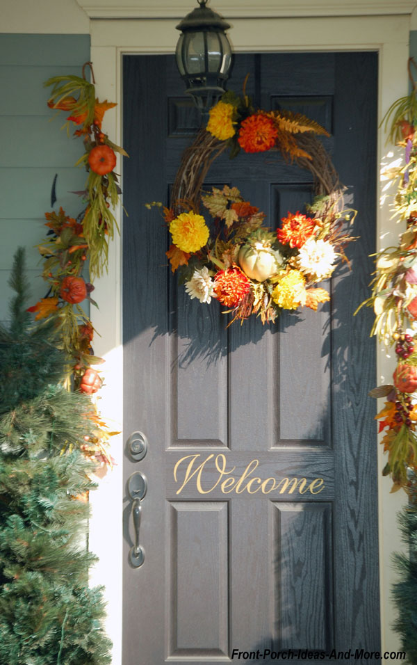 colorful autumn garland and front door wreath