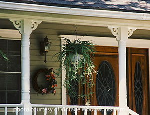 white brackets on porch columns