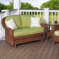 luxurious wicker rattan glider on porch