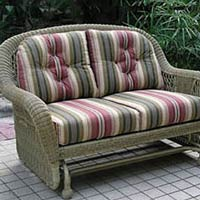 Wicker glider with striped cushy cushions